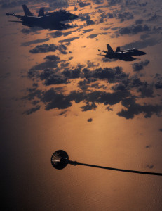 Two Canadian F-18 aircraft are pictured waiting to begin air-to-air refuelling from a RAF VC10 K3 of 101 Squadron, Royal Air Force during a mission as part of Operation Unified Protector, NATO's Libyan mission.
