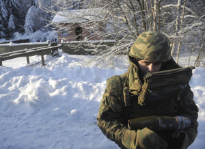 Field engineer in Dublon protection suit holding a shell during the military exercises of Guards Engineer Brigade and Engineer Camouflage Regiment of Russian army