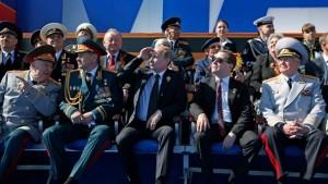 Sergey Shoigu, Vladimir Putin and Dmitry Medvedev 9 May 2013