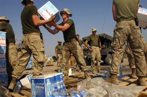 US Marines load water and humanitarian aid ahead of OP Sweeney in Iraq, 2003
