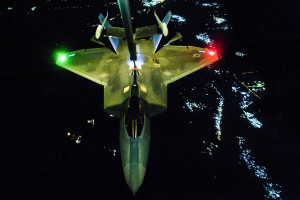 An U.S Air Force KC-10 Extender refuels an F-22 Raptor fighter aircraft prior to strike operations in Syria, Sept. 26, 2014. These aircraft were part of a strike package that was engaging ISIL targets in Syria. (U.S. Air Force photo by Tech. Sgt. Russ Scalf)