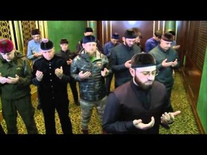 Kadyrov (in fatigues) praying with local religious leaders