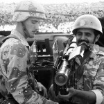 A member of the 1st Battalion, 325th Airborne Infantry Regiment, stands by as a Saudi Arabian national guardsman sights an FIM-92A Stinger portable anti-aircraft missile launcher.  The Stinger is being exhibited as part of an equipment and hardware static display during Operation Desert Shield.