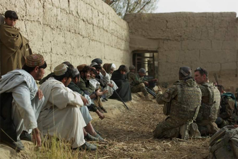 British Lt. Col. Andrew Harrison, 2nd Battalion, The Parachute Regiment commander, conducts a shura with Tor Ghai village elders after ISAF and ANA secured the village during a recent operation.