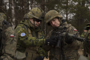 Corporal Alex Mazzocci from The Black Watch (Royal Highland Regiment) explains the mechanics of a C7 rifle to a Polish soldier at the Drawsko Pomorskie Training Area, Poland during Operation REASSURANCE on March 15, 2016. Photo: Master Corporal Andrew Davis, Operation REASSURANCE Land Task Force Imagery Technician RP002-2016-0023-007