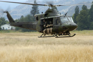 A CH-146 Griffon Helicopter from 427 Special Operations Aviation Squadron (427 SOAS) takes off after recovering troops from the Canadian Special Operations Regiment (CSOR) during a training exercise near Kamloops, BC.