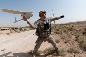 U.S. Army 1st Lt. Steven Rose launches an RQ-11 Raven unmanned aerial vehicle near a new highway bridge project along the Euphrates River north of Al Taqqadum, Iraq, Oct. 9, 2009. Rose is assigned to Charlie Company, 1st Battalion, 504th Parachute Infantry Regiment, 1st Brigade Combat Team, 82nd Airborne Division, which is assisting Iraqi police in providing security for the work site. (DoD photo by Spc. Michael J. MacLeod, U.S. Army/Released)
